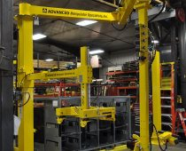 UltiBalance with UltiRail Pneumatic Manipulator System Lifts and Combines Gas Tank and Skid Plate